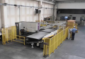 View of the punch press Muratec-Wiedemann Motorum 2558 and of the sheet metal loadingunloading warehouse F1G-1500, supplied by Co.Ma.F.