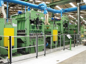 Central section of the flattening line 2,000 x 20 mm, view of flattening machines and tandem brushing machines.