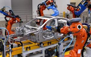 Jaguar-XE-enters-production-robot-assembly