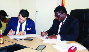 Industry-and-commerce-minister-Mike-BimhaR-and-the-president-of-El-Badaoui-group-Georges-El-Badaoui-at-the-signing-ceremony-in-Harare