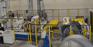 View of Asservimenti Presse plant, studied to process sheet metals of high-strength steels, too (up to 1,250 mm of width, in thicknesses from 5 to 16 mm) on a hydraulic press by Cavenaghi & Ridolfi Spa featuring 20,000 kN