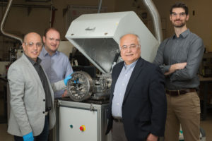 """Researchers from Argonne's Surface and Lubrication Interaction, Discovery and Engineering initiative developed a novel """"diamond-like"""" coating that could prove of great benefit when used to coat equipment for wind turbines, like the bearing in this photo. Pictured from left, Levent Eryilmaz, Giovanni Ramirez, Ali Erdemir and Aaron Greco."""