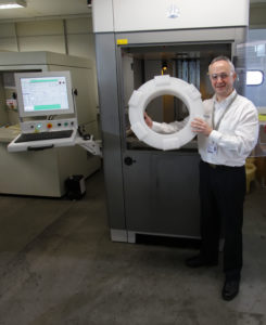Cti's Richard Gould with an SLA replica pattern in front of the Stereolithography Additive Manufacturing machine that made it